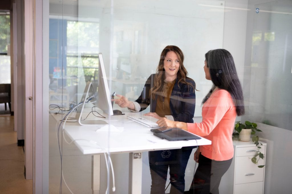 Two women collaborating in the office